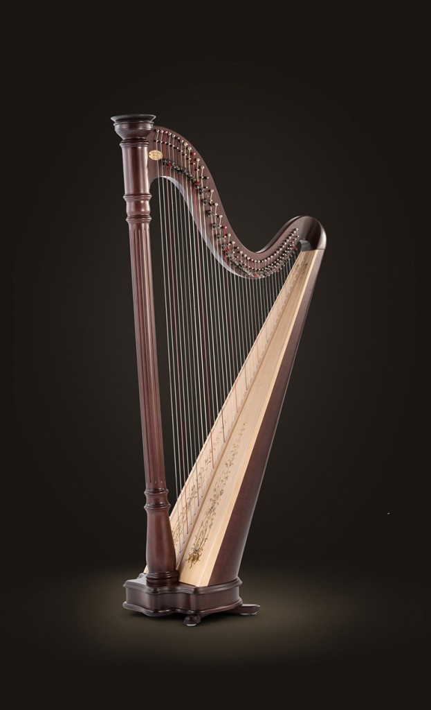 "$39500 Prelude 40 1st octave E to 6th octave A  Height 64 "" (163 cm) Extreme Width 33 1/4 ""(84 cm) Weight 44 lbs (20 Kg) Natural, mahogany and ebony finishes Designed with the performing harpist in mind, this romantic classic is crafted with a decorated Sitka Spruce soundboard for a rich, powerful tone. Now with 40 strings to accommodate a larger range of music, the artistically styled Prelude 40 lever harp features string spacing and tension similar to a traditional Lyon & Healy pedal harp. Included with the new Prelude 40 are a scalloped bronze-finished crown and matching claw feet, as well as a classically turned wooden crown and stylized feet. All pieces complement the elegant lines of its graceful base and delicately fluted column, plus they allow you to customize the look of your Prelude 40 to your individual taste (click on harp to the left to see all looks). Available in natural, mahogany and ebony finishes; fitted with Performance levers 1st octave C to 6th octave C. The Prelude comes with a cover, tuning key and a 2-year limited warranty."